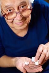 Senior female with pills