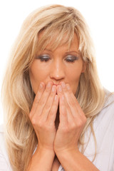 Woman covering her mouth with hands