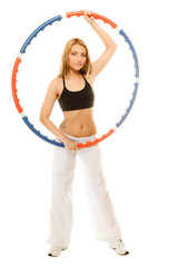 sporty fit girl doing exercise with hula hoop.