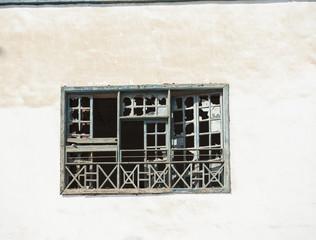 Broken window in old derelict house