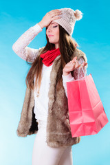 stressed woman with shopping bag