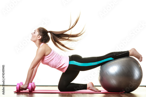 canvas print picture woman with gym ball and dumb bells isolated