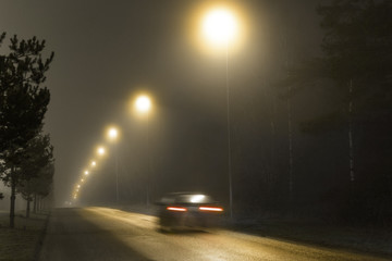 Car in foggy night