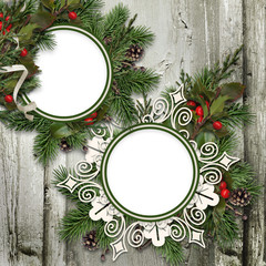Grungy wooden background with Christmas wreaths and frames
