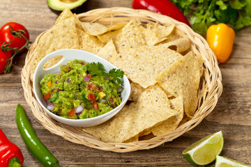 Guacamole with avocado, lime, tomato and cilantro