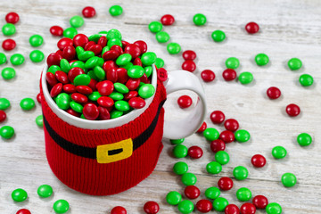 Holiday cup spilling of Candy onto old wood