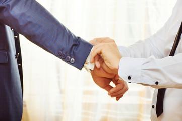 Hands of wedding groom