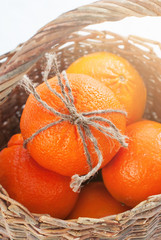 Watlled Basket with Oranges at the Snow