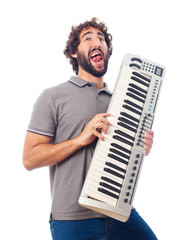 young crazy man with a piano