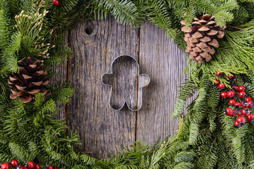 Christmas Wreath with Gingerman Cookie in the Middle of Wood Bac