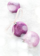 Violet Balls with a Bow from Ribbon at the Snow