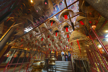 The interior of the Man Mo Temple, Hong Kong, with incense offer