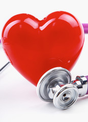 A heart with a stethoscope lying
