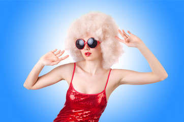 Cute woman in afro wig