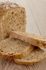 whole grain bread isolated on wood background