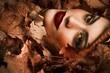 Girl among leaves