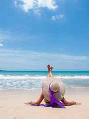 girl sitting on a tropical beach