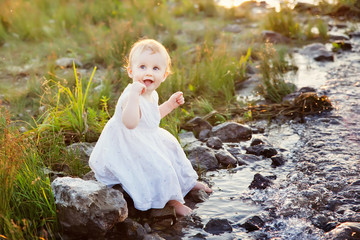 little girl and creek