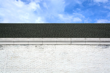 roof and brick wall with blue sky