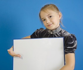 the girl shows a white plastic board