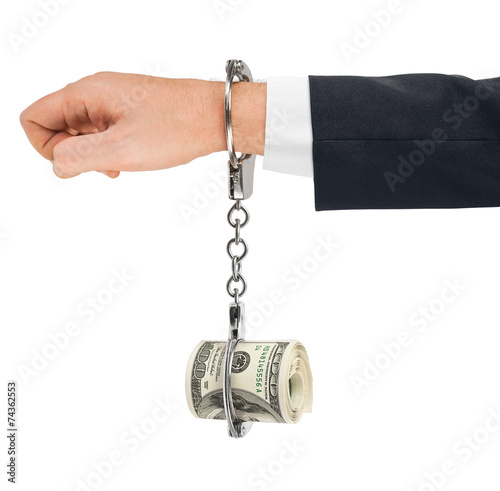 canvas print picture Hand with handcuffs and money