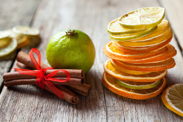 Stack of dried orange and lemon slices, lime and cinnamon sticks