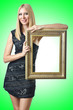 Woman holding picture frame on white