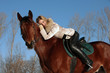 Romantic female jockey riding a horse outdoors
