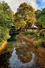 Wooden bungalows on tropical shore in the Chiew Lan Lake, Khao S