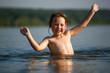 Adorable  baby girl splashing in a beautiful sea