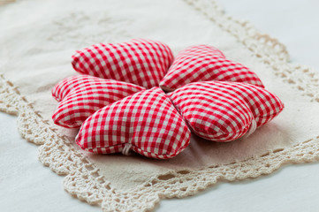 Homemade red hearts on lace napkin