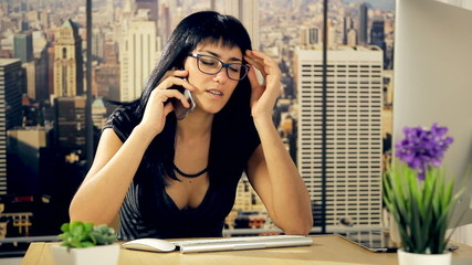 Business woman tired with headache in office