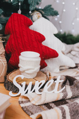 Cute knitted pillows, toys and presents under the Christmas tree