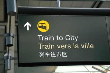 Train to city sign