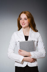 Businesswoman in business concept  with book