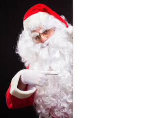 Santa Claus showing a blank sign