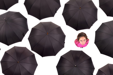 Girl amongst umbrellas