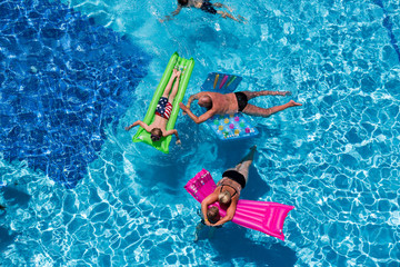 Family  relaxing on swimming-pool
