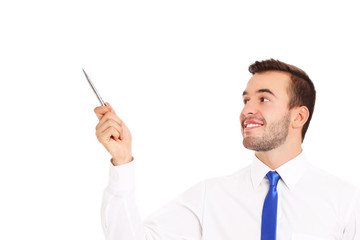 Businessman pointing at something with a pen