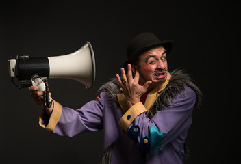 Clown shouting at the megaphone