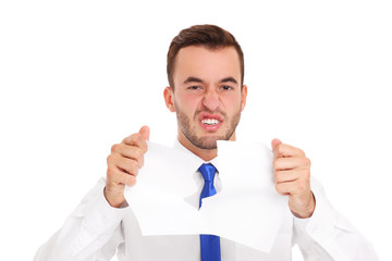Businessman tearing documents