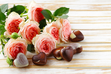 chocolate candy hearts and pink roses for Valentine's day