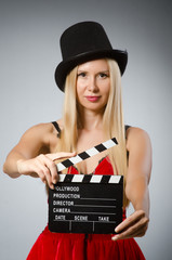 Woman with movie board wearing vintage hat