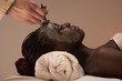 African woman having clay facial mask - 74367788