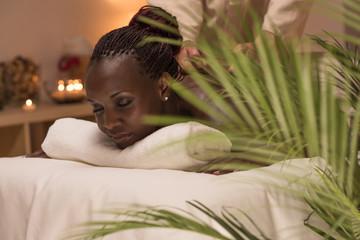 Masseur doing massage to african woman