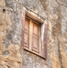 wooden window in an old wall