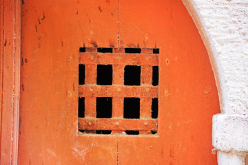grating in an old orange door