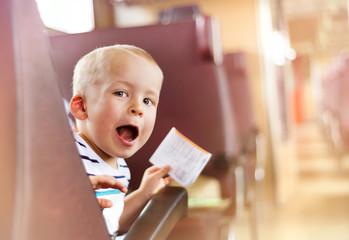 Boy travelling in train