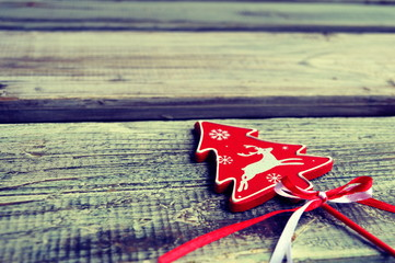 Christma s tree decorative element on a wooden background
