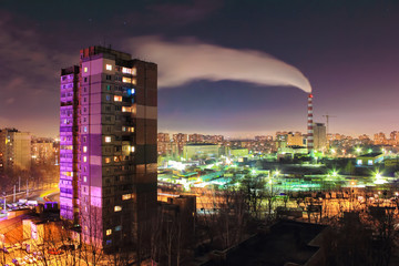 The smoke from industrial pipe in the city at night